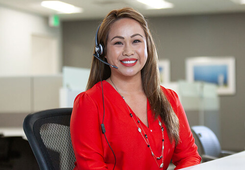 Bay Alarm Support employee answering phone call